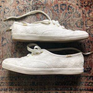 40b937a7a9e kate spade Shoes - Kate Spade Champion Daisy Lace and Gold Keds